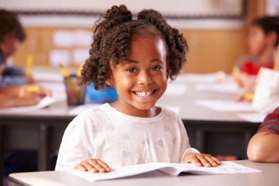 African American elementary school girl in class