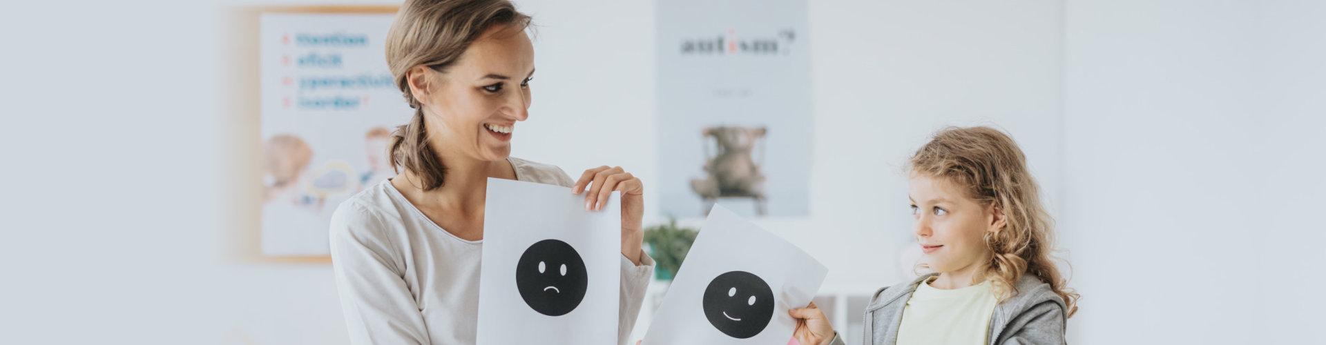 psychologist teaching child to communicate